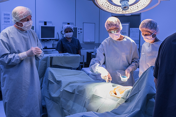 Healthcare staff in a hospital environment performing a surgery